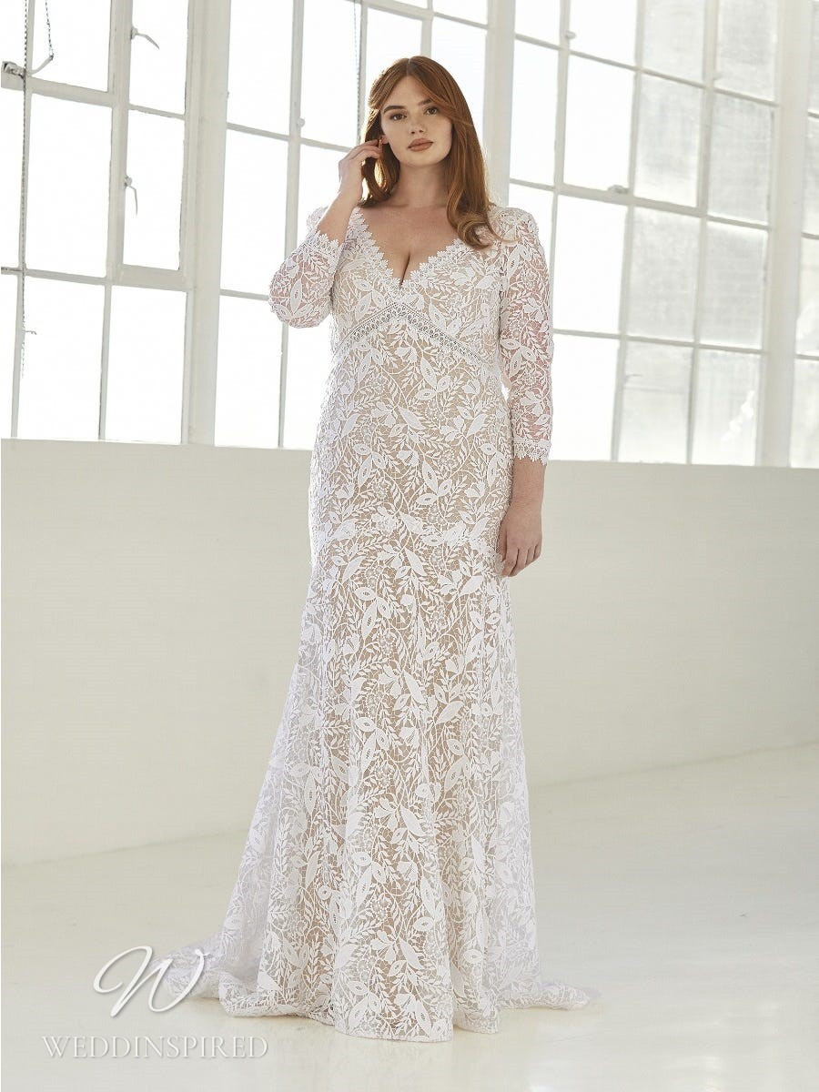 An Ashley Graham x Pronovias 2021 plus size lace mermaid wedding dress with a v neck and long sleeves