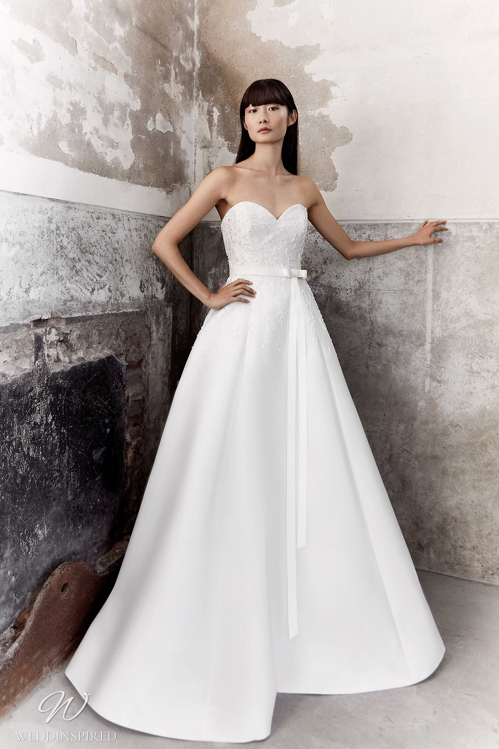 A Viktor & Rolf Fall/Winter 2021 simple strapless ball gown wedding dress with a sweetheart neckline