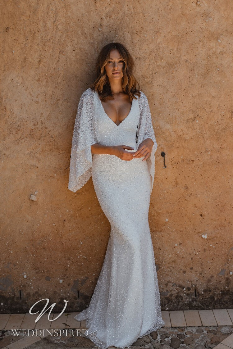 An Anna Campbell 2021 sparkly white mermaid wedding dress with a v neck