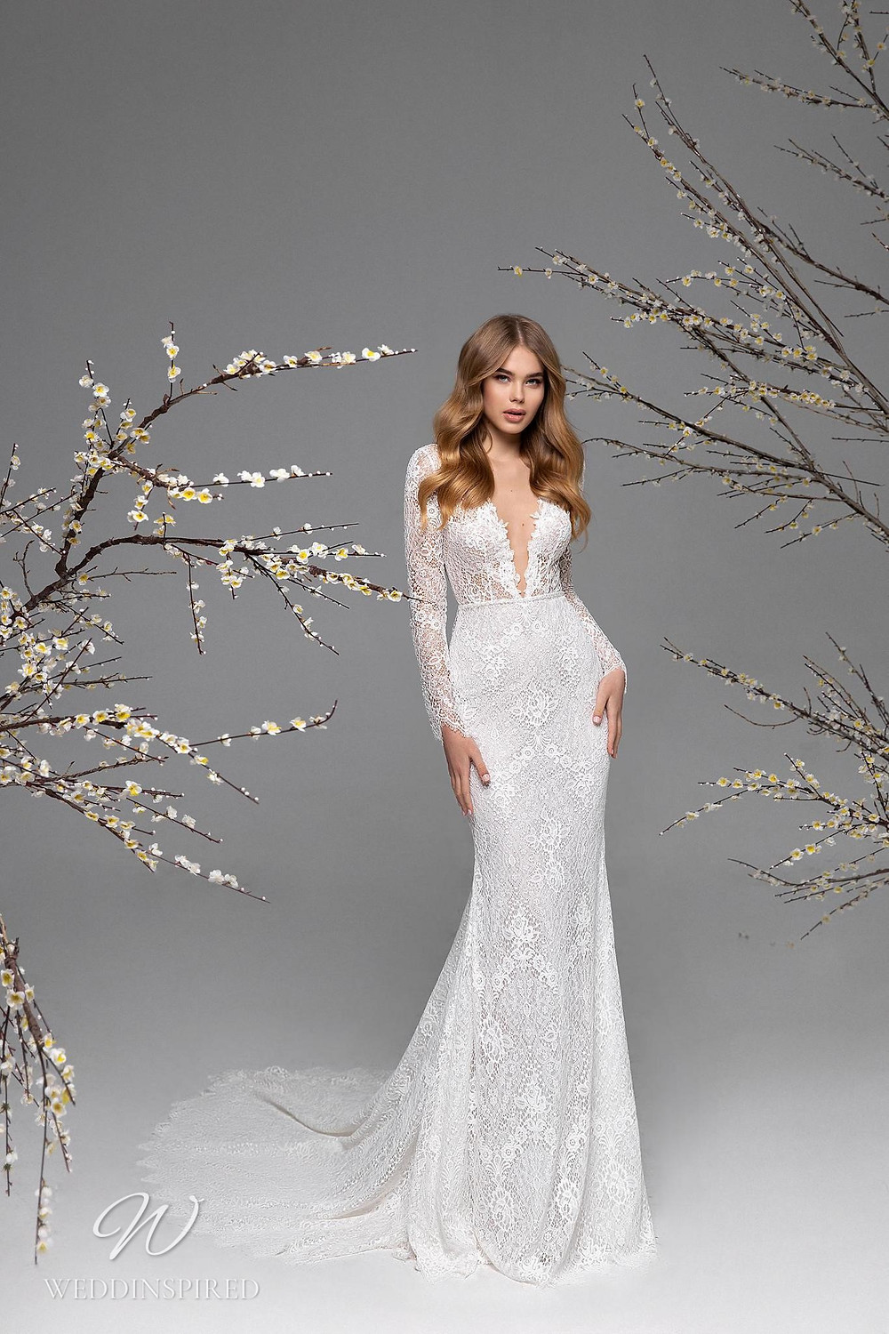A Ricca Sposa lace mermaid wedding dress with long sleeves and a train