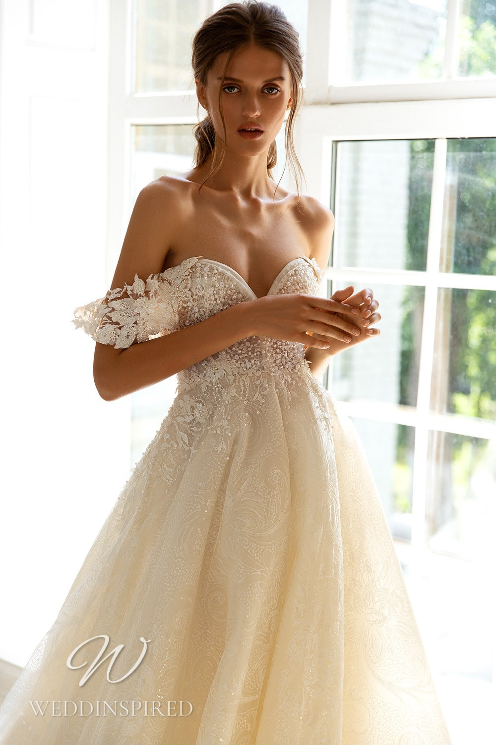 A WONÁ Concept 2021 lace and tulle off the shoulder A-line wedding dress