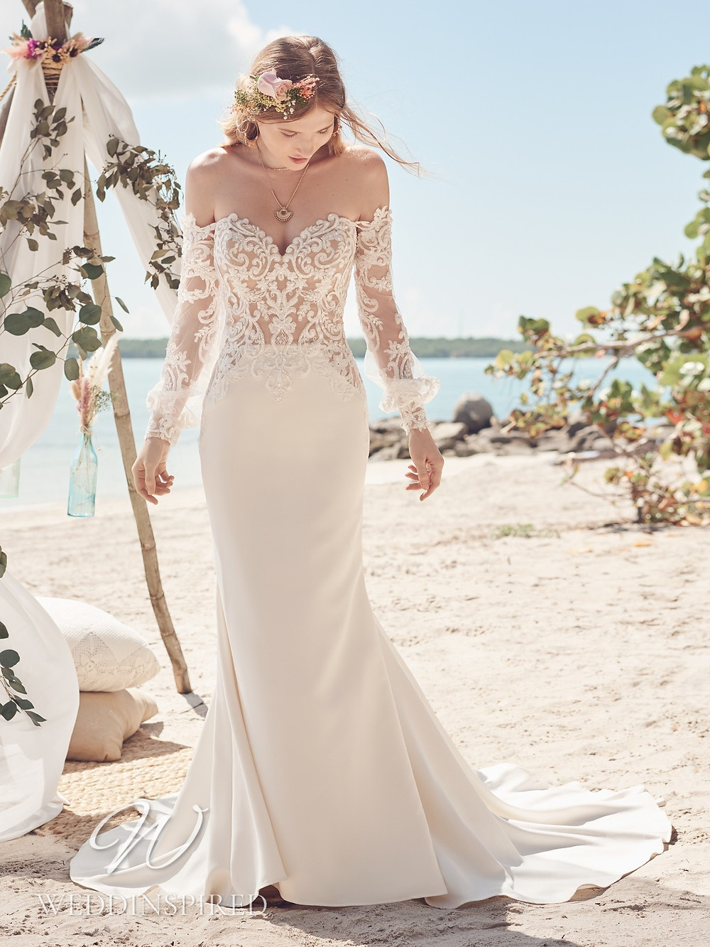 A Rebecca Ingram 2021 off the shoulder lace and satin mermaid wedding dress with long sleeves