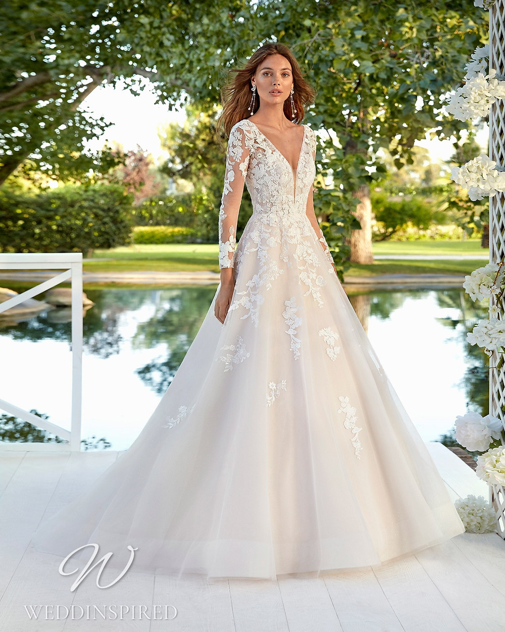 An Aire Barcelona 2021 lace and tulle A-line wedding dress with long sleeves
