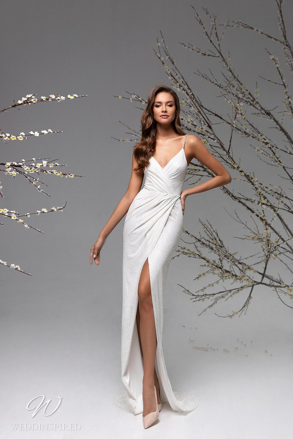 A Ricca Sposa sexy fitted wedding dress with a high slit