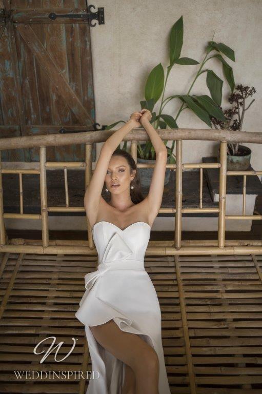 A David Hasbani satin strapless A-line wedding dress with a bow