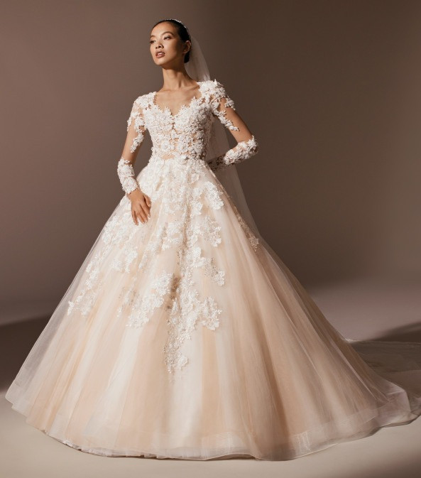 A Pronovias lace and tulle blush princess ball gown wedding dress