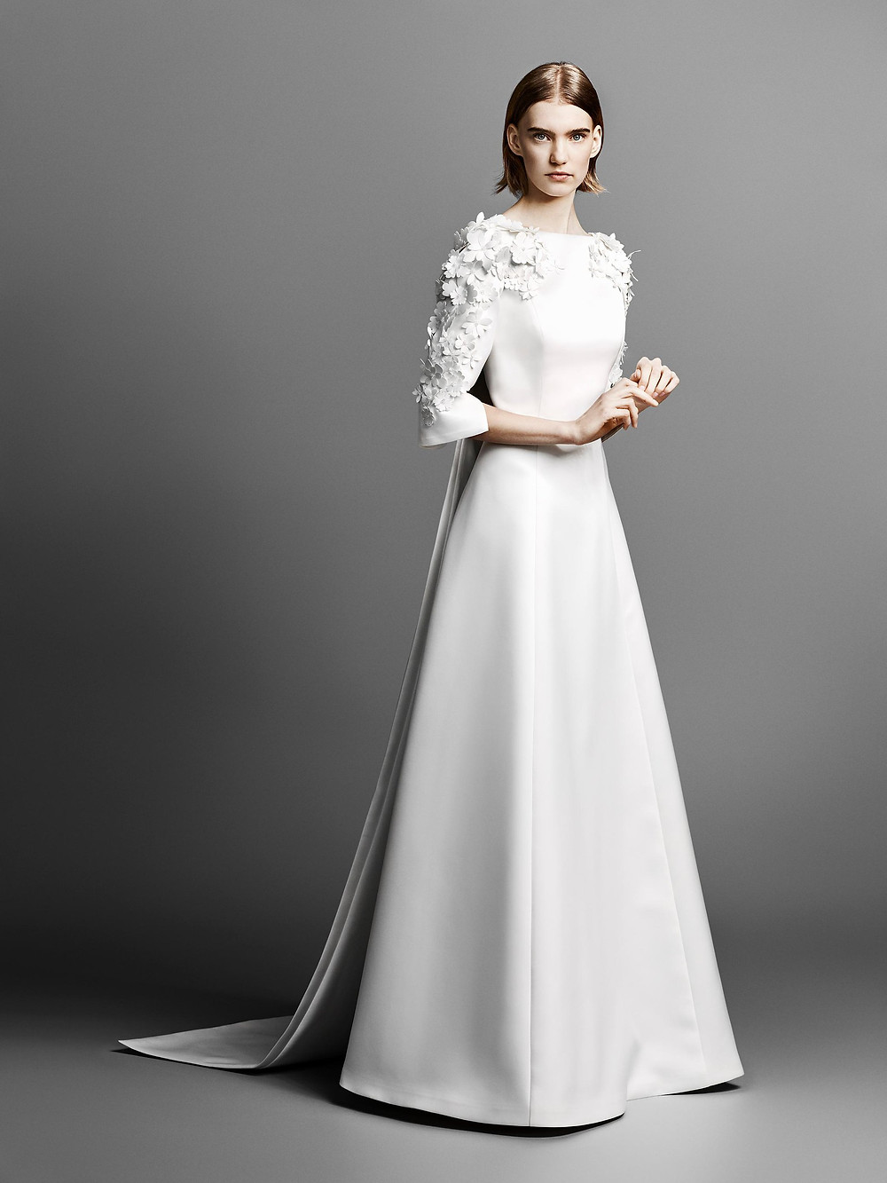 A Viktor & Rolf modest 3/4 sleeve, A-line wedding dress with flowers