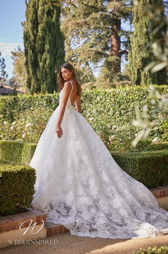 A Monique Lhuillier lace princess ball gown wedding dress with a low back