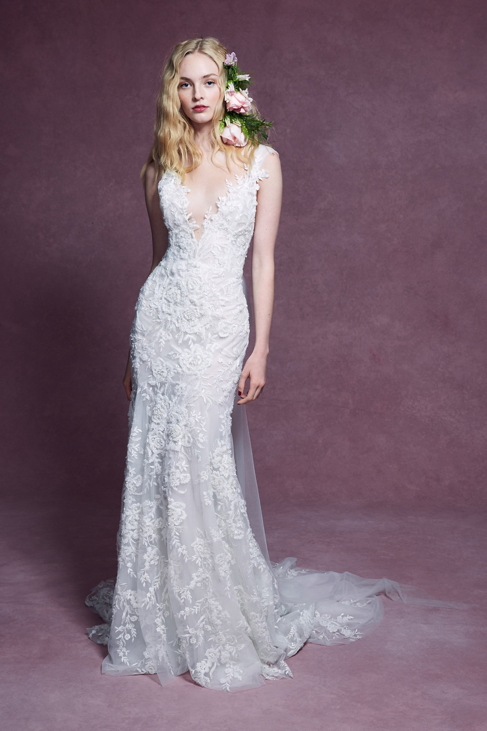 A Marchesa 2020 lace mermaid wedding dress with a low v neckline and delicate embroidery