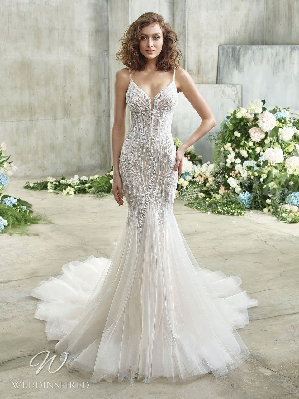 A Badgley Mischka gauzy mermaid wedding dress with a tulle skirt, beading and spaghetti straps