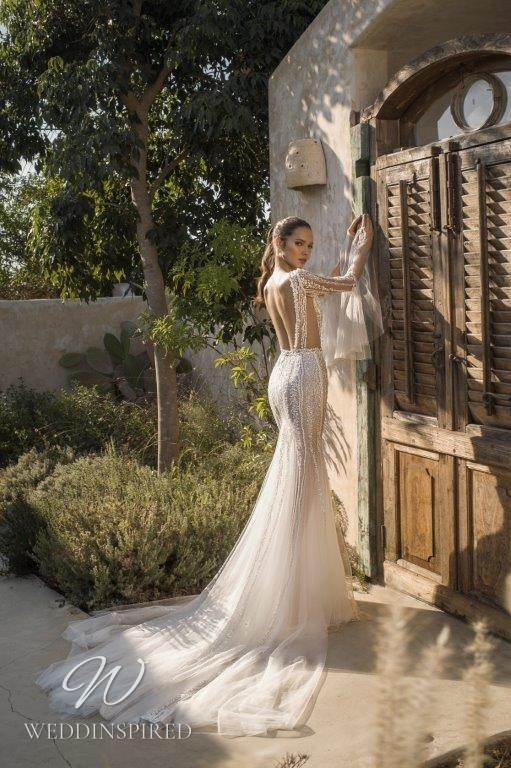 A David Hasbani lace and tulle mermaid wedding dress with long sleeves