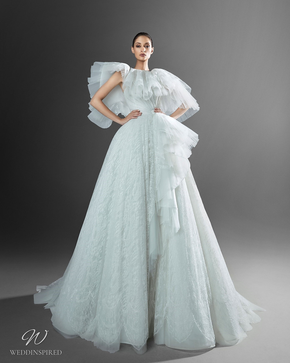 A Zuhair Murad strapless light blue princess ball gown Cinderella wedding dress with a tulle skirt and a removable tulle neck piece