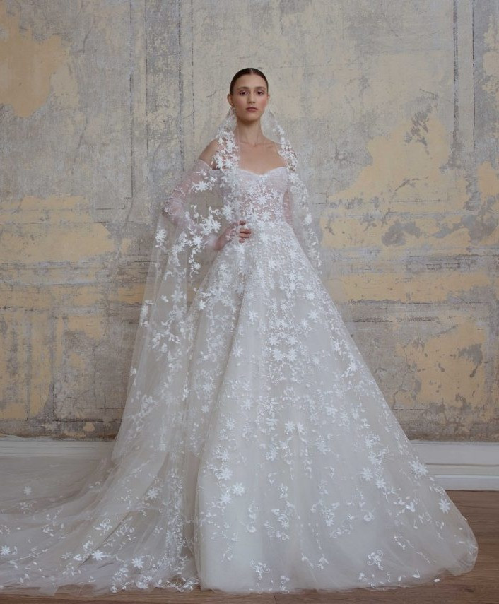 A Georges Hobeika 3/4 sleeve, ball gown wedding dress, with lace and a tulle skirt