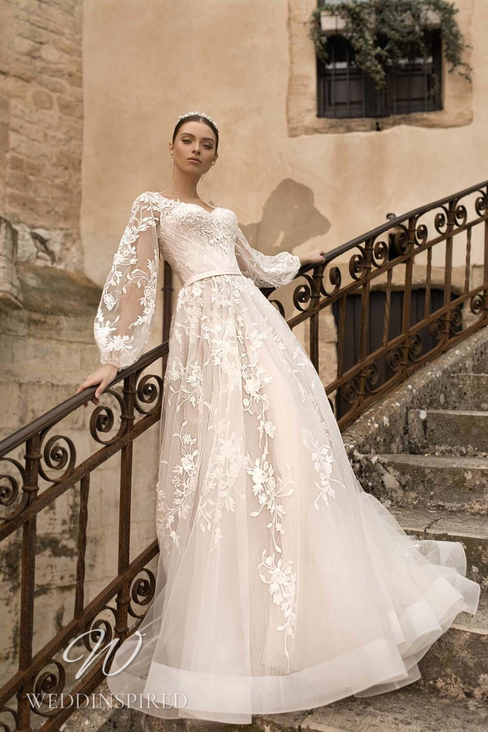 A Lussano 2021 boho lace and tulle A-line wedding dress with long sleeves
