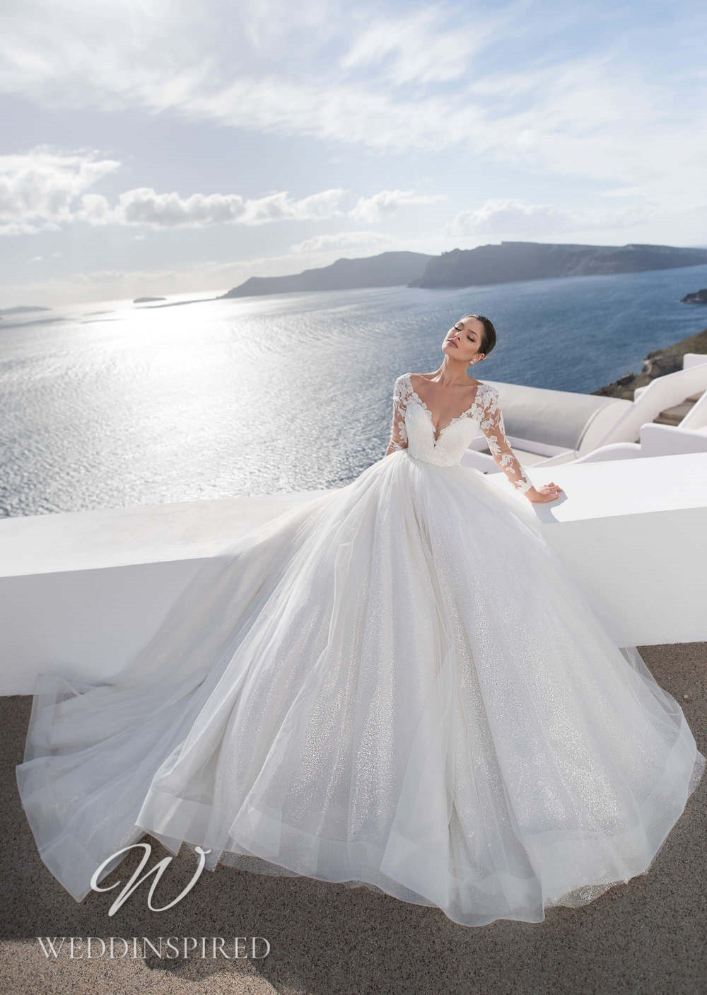 A Blunny 2021 lace and tulle princess wedding dress with long sleeves