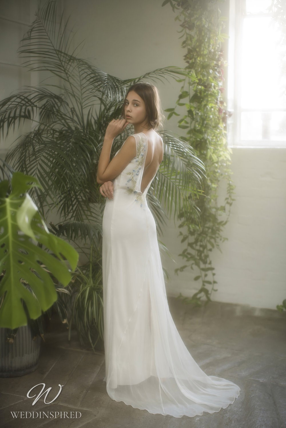 An Olwen Bourke loose fitting chiffon sheath wedding dress with a low back and floral embroidery