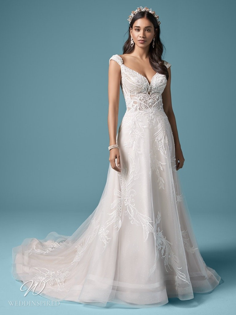 A Maggie Sottero 2021 lace and tulle A-line wedding dress with cap sleeves