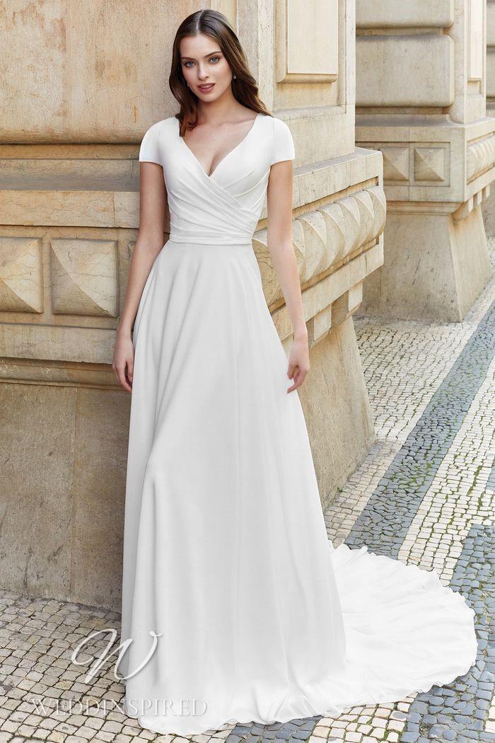 A Justin Alexander 2021 crepe sheath wedding dress with cap sleeves