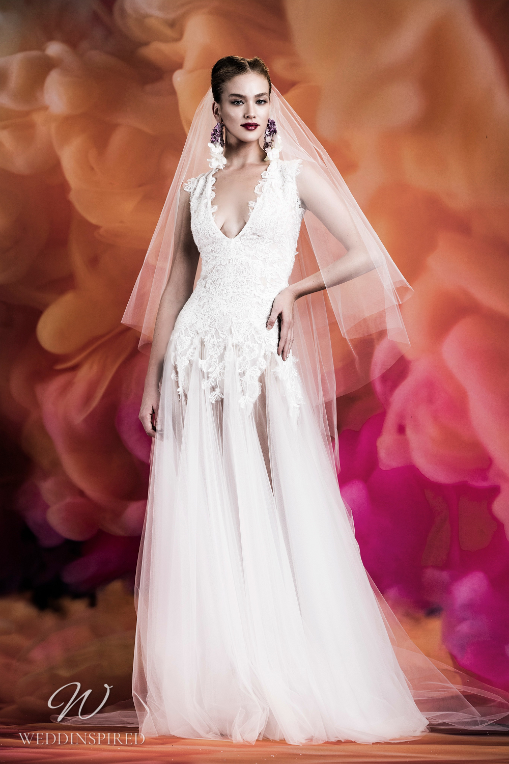 A Naeem Khan lace and tulle A-line wedding dress with straps and a low v neckline