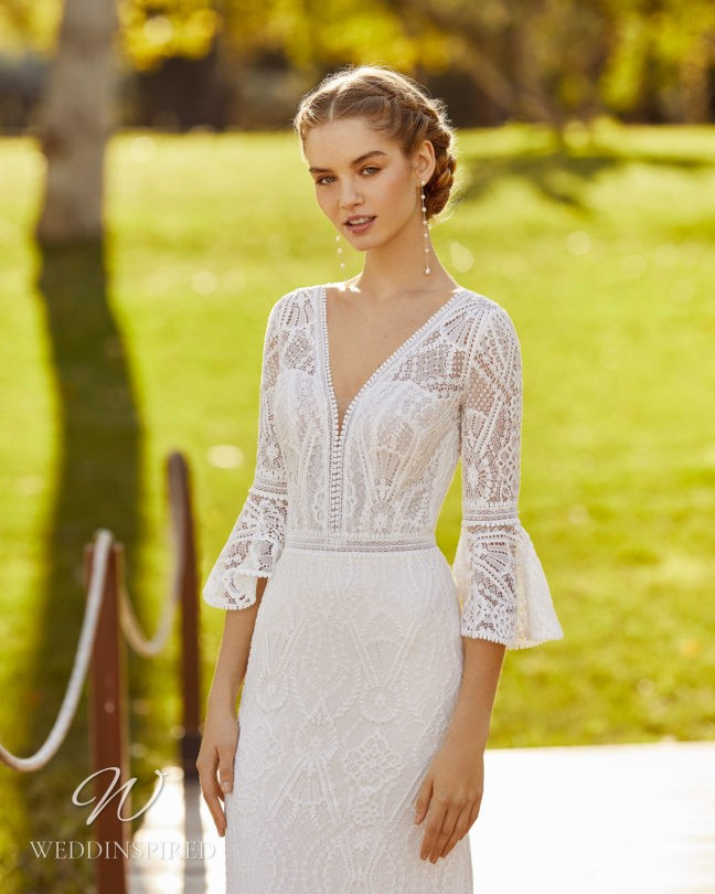 An Aire Barcelona 2021 boho lace A-line wedding dress with a v neck and half sleeves