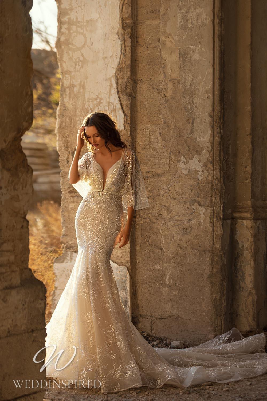An Eva Lendel 2021 lace and tulle blush mermaid wedding dress