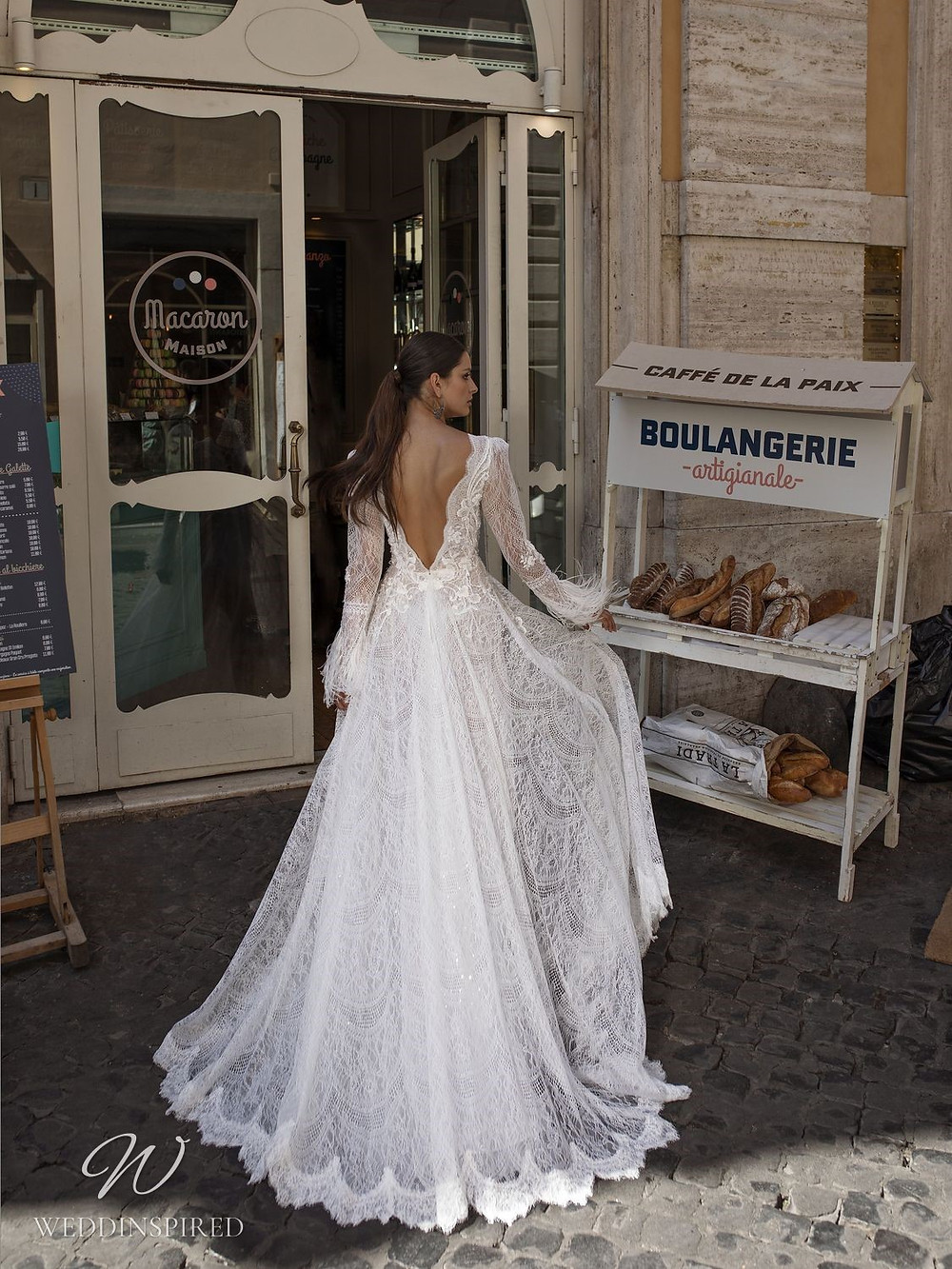 A Pinella Passaro lace A-line wedding dress with long sleeves and a low back