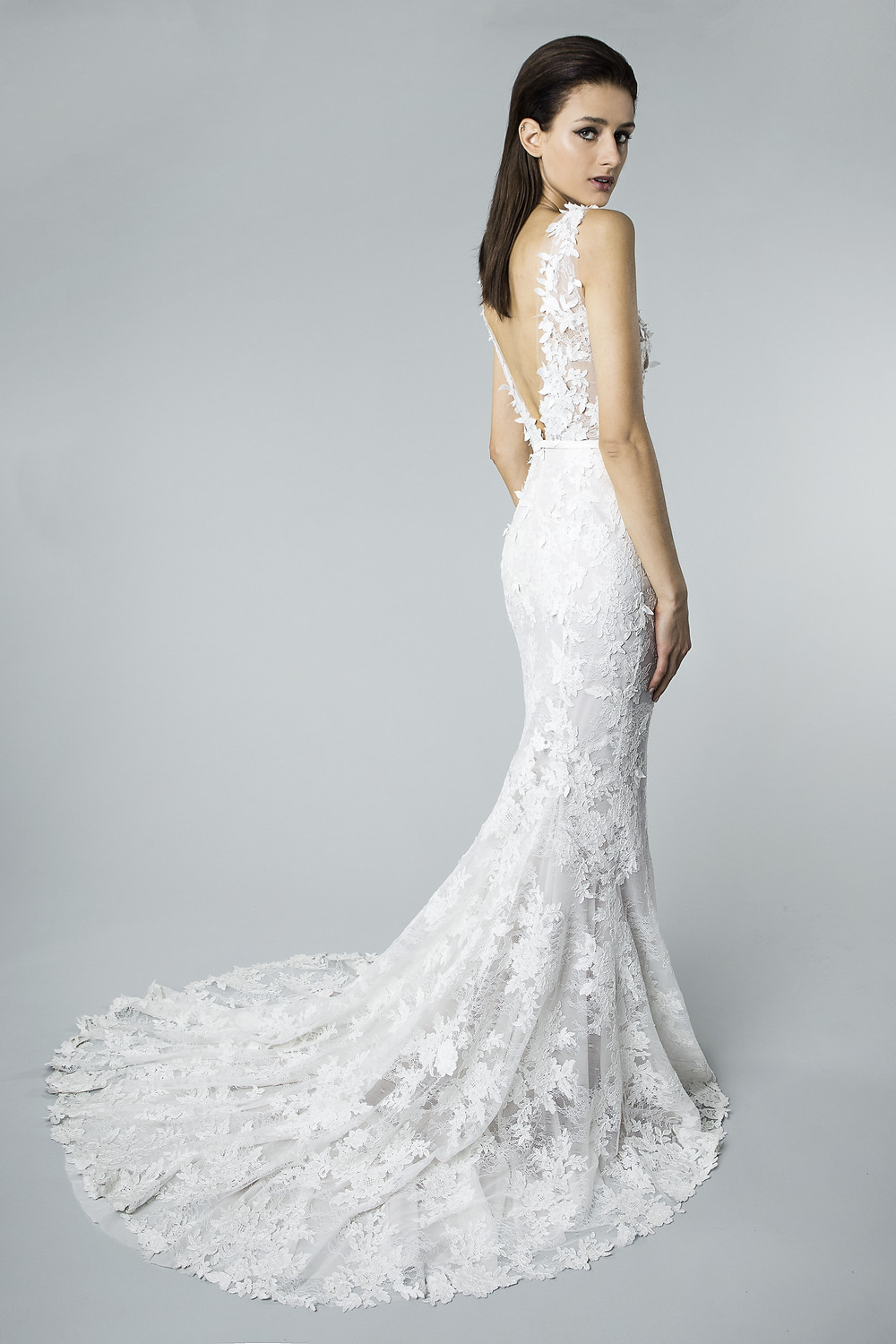 A Mira Zwillinger lace mermaid fit and flare wedding dress with a low back