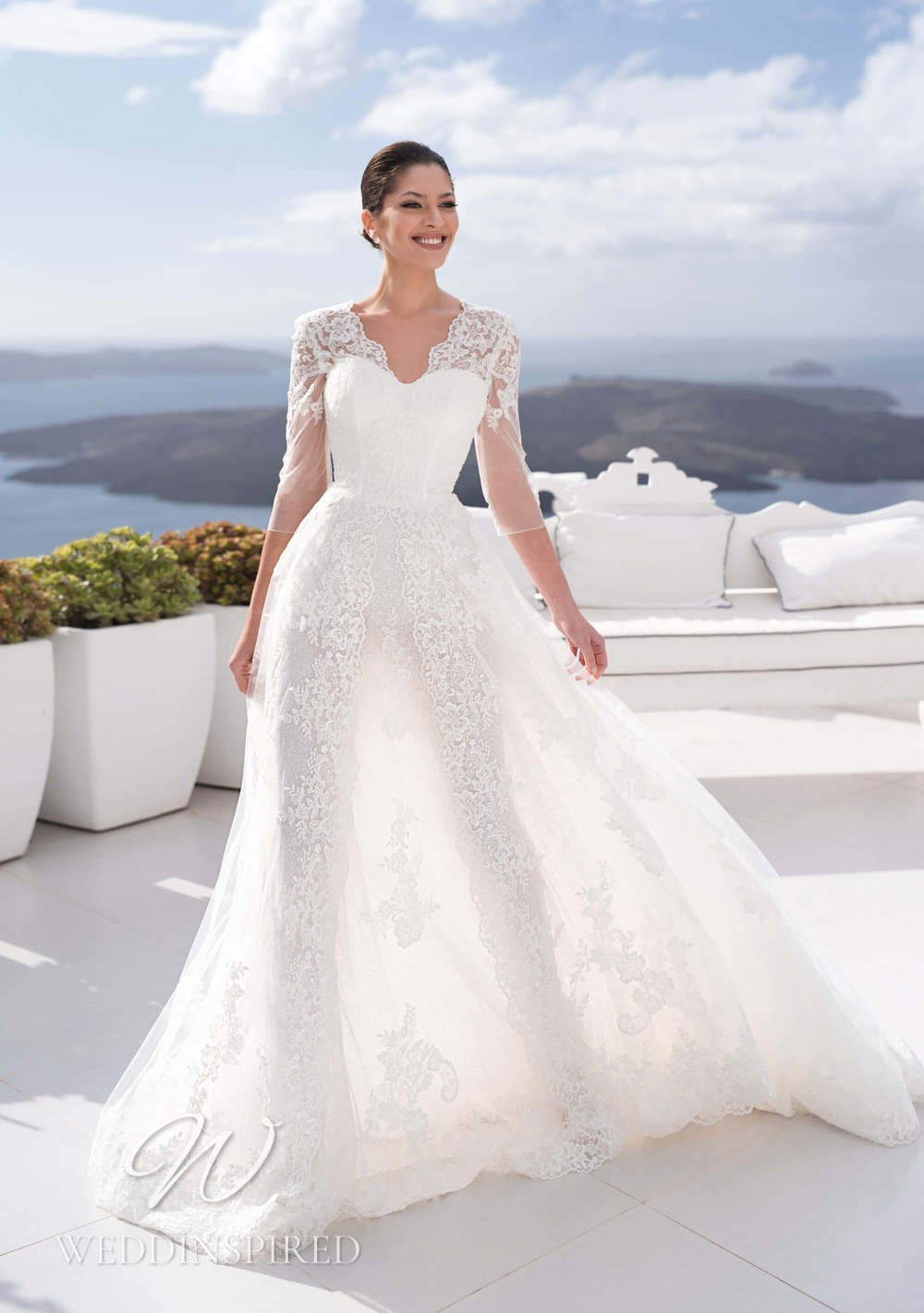 A Blunny 2021 lace A-line wedding dress with 3/4 sleeves