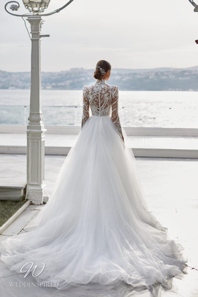 A Milla Nova 2021 lace and tulle A-line wedding dress with long sleeves and a high neckline