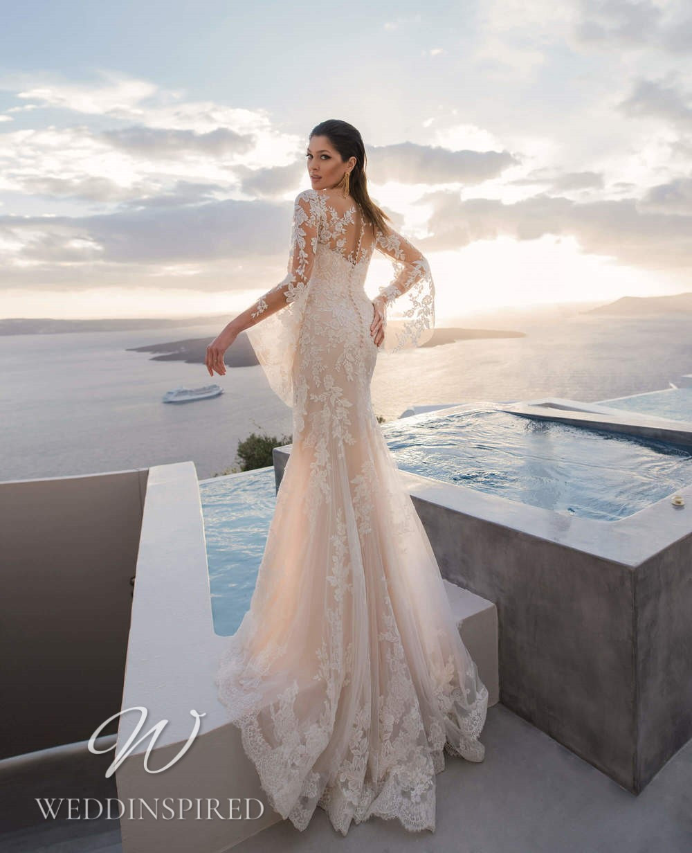 A Blunny 2021 blush lace mermaid wedding dress with long sleeves
