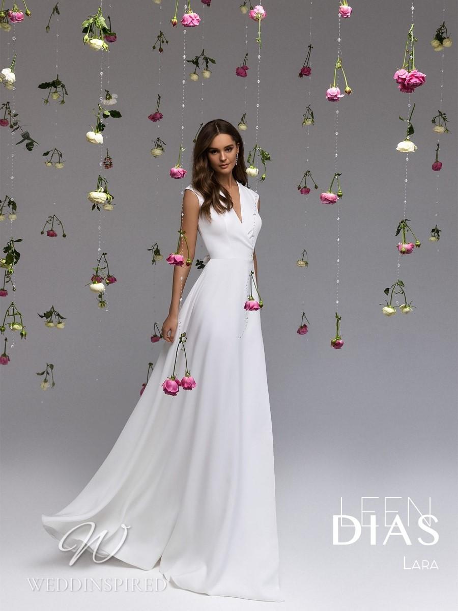 A Leen Dias 2021 simple satin A-line wedding dress with a v neck