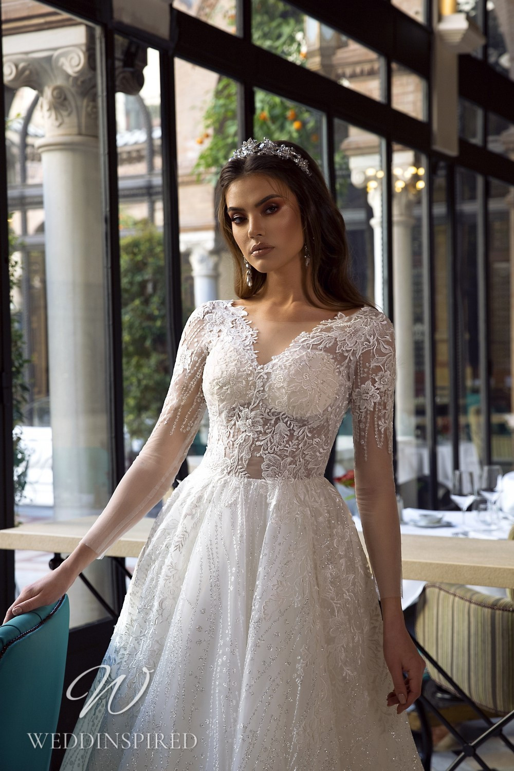 A Maks Mariano lace princess wedding dress with long sleeves