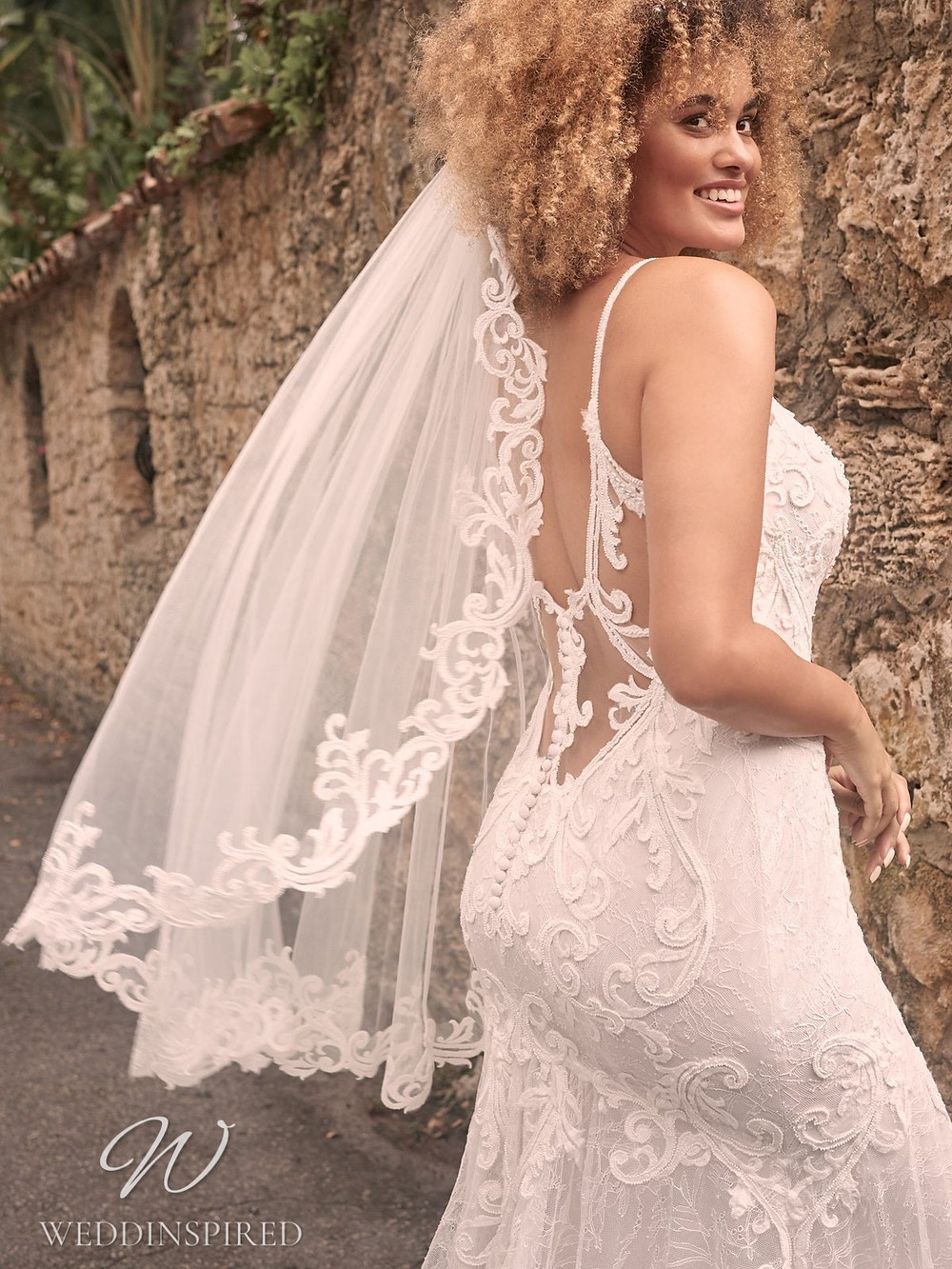 A Maggie Sottero Spring 2021 lace mermaid wedding dress with straps