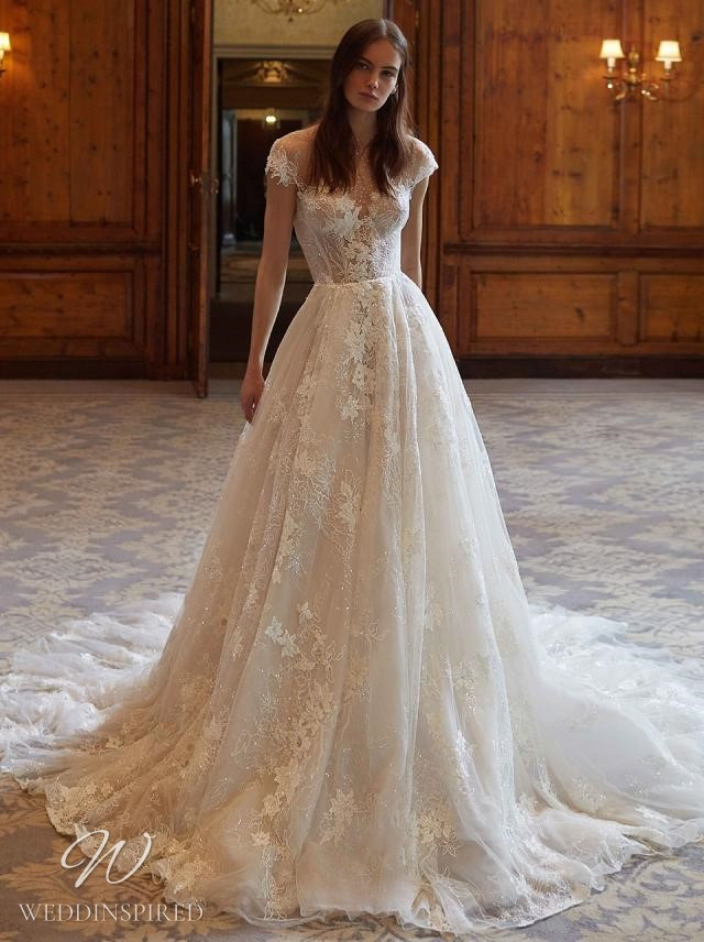 A Galia Lahav 2021 ivory lace and tulle A-line wedding dress with cap sleeves and an illusion neckline