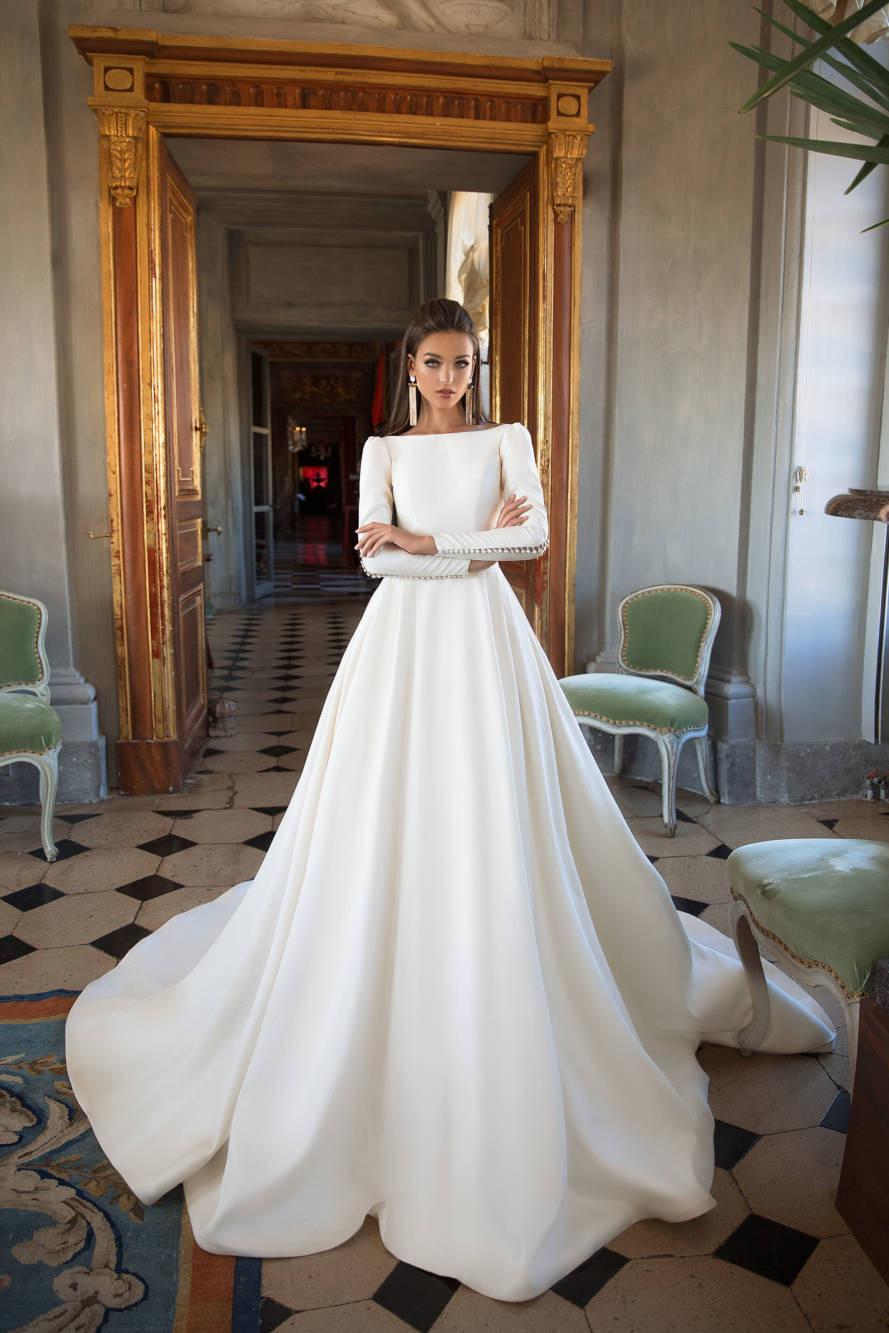 A Milla Nova silk princess ball gown wedding dress with long sleeves