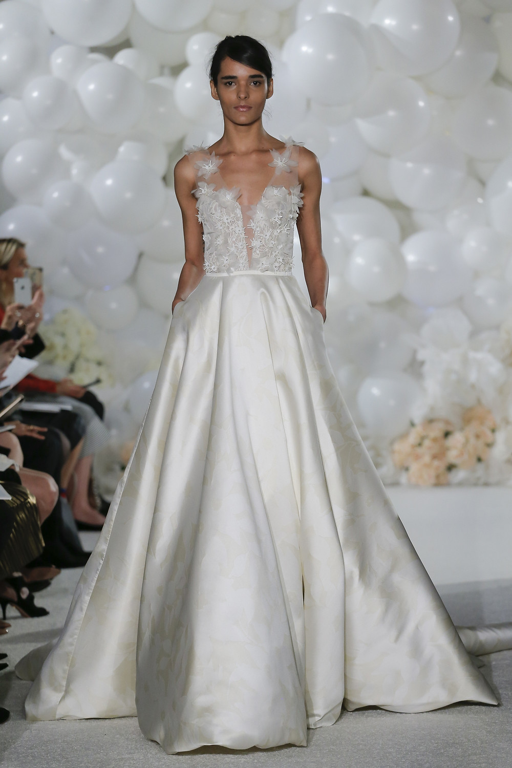 A Mira Zwillinger silk ball gown wedding dress with pockets and tulle flowers
