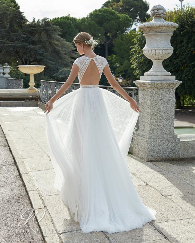 An Aire Barcelona 2021 lace and tulle boho A-line wedding dress with an open back