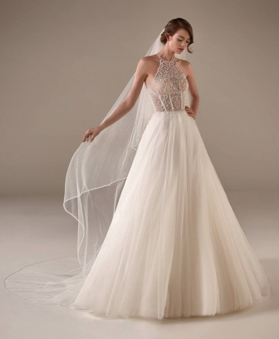 A Pronovias blush halterneck lace and tulle A-line wedding dress