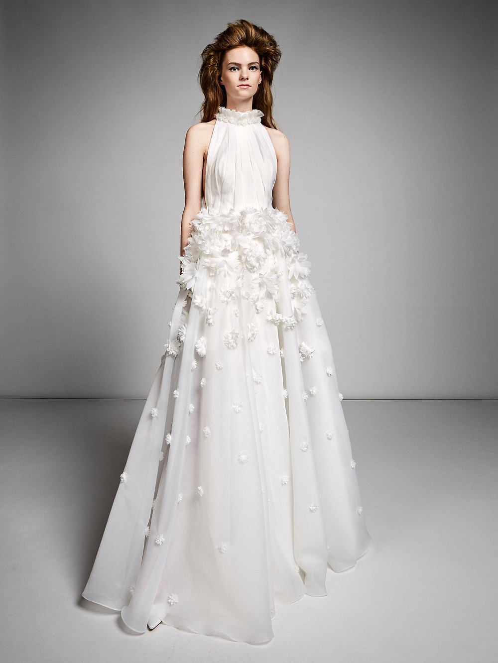 A Viktor & Rolf halterneck A-line wedding dress with flowers