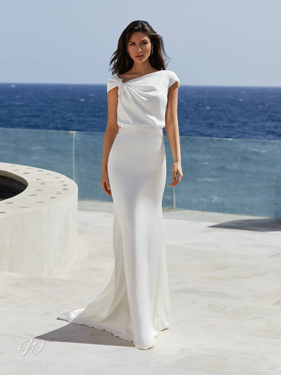 A Pronovias 2021 simple Grecian style column wedding dress with one shoulder