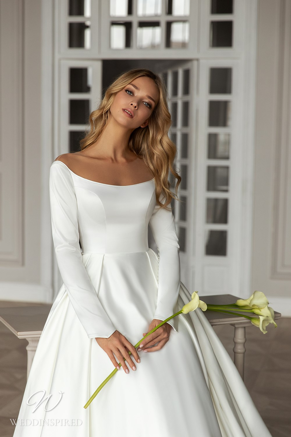 An Eva Lendel 2021 simple off the shoulder silk ball gown wedding dress with long sleeves