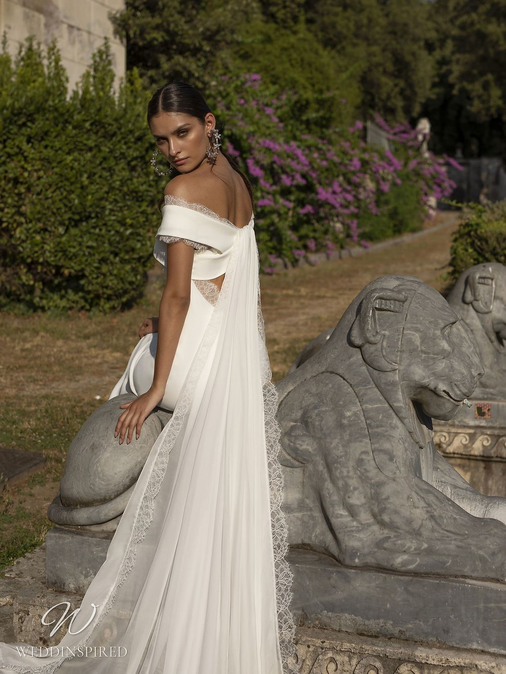 A Pinella Passaro off the shoulder lace and silk mermaid wedding dress with a detachable veil or cape