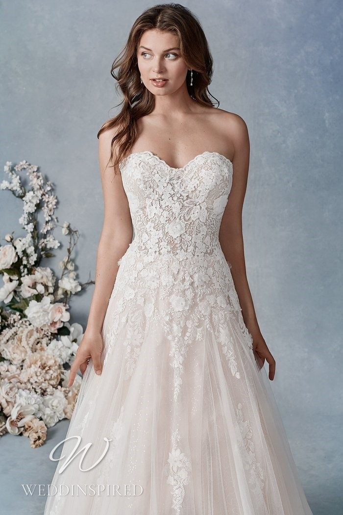 A Kenneth Winston 2021 strapless lace A-line wedding dress
