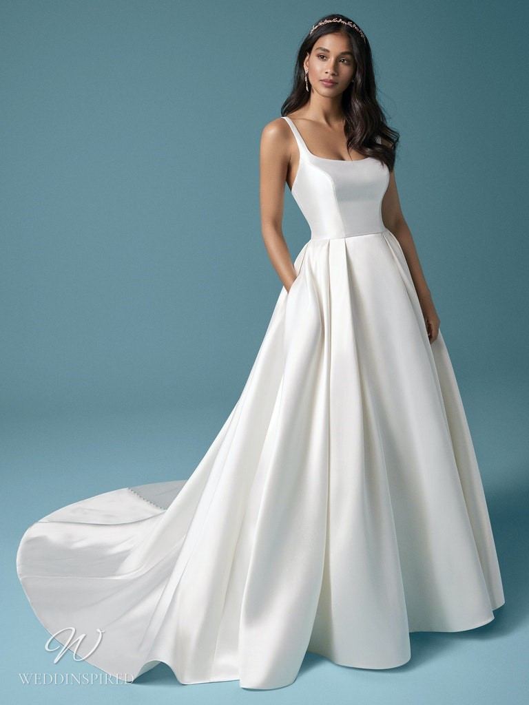 A Maggie Sottero 2021 simple silk ball gown wedding dress with pockets