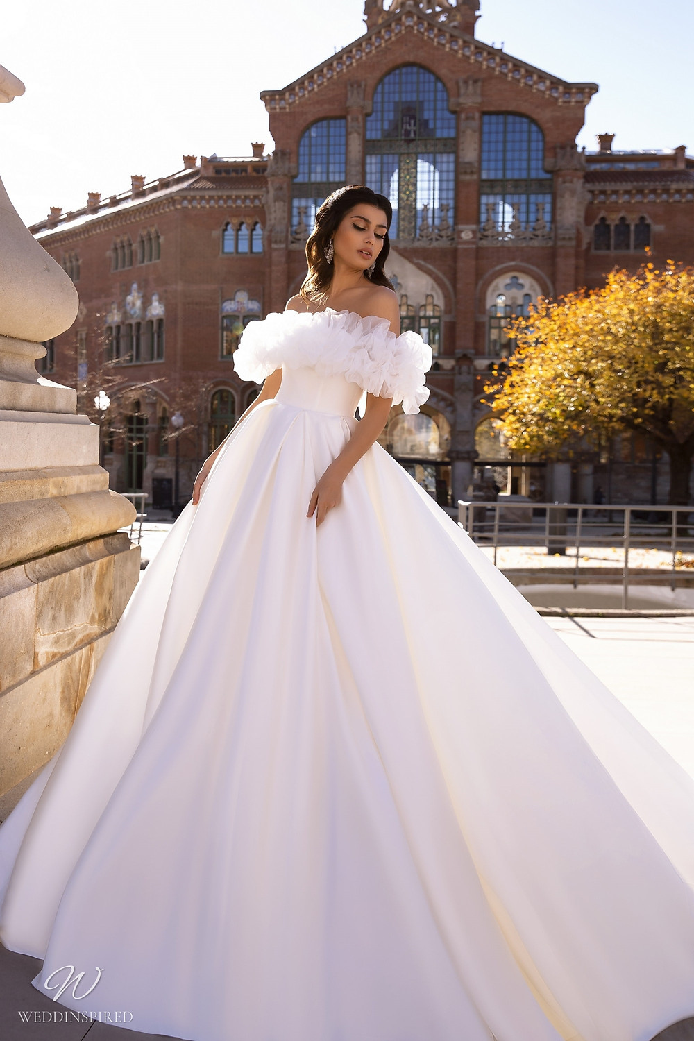 A Maks Mariano off the shoulder silk and tulle princess ball gown wedding dress