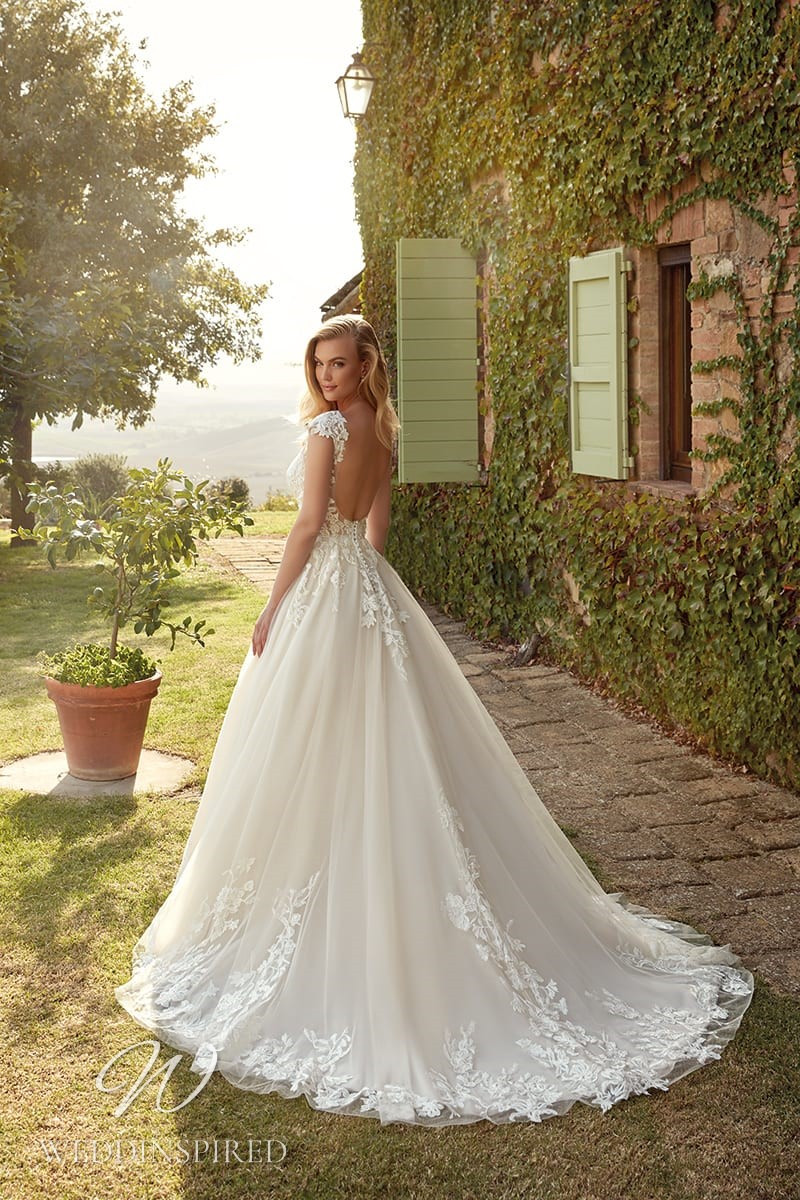 An Eddy K 2021 lace and tulle A-line wedding dress with a low back