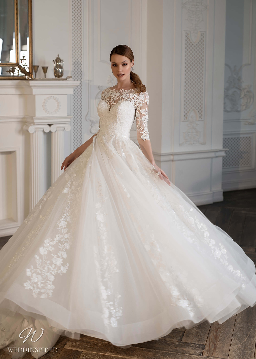 A Naviblue Bridal 2021 romantic lace and tulle ball gown wedding dress with half sleeves and a sweetheart neckline