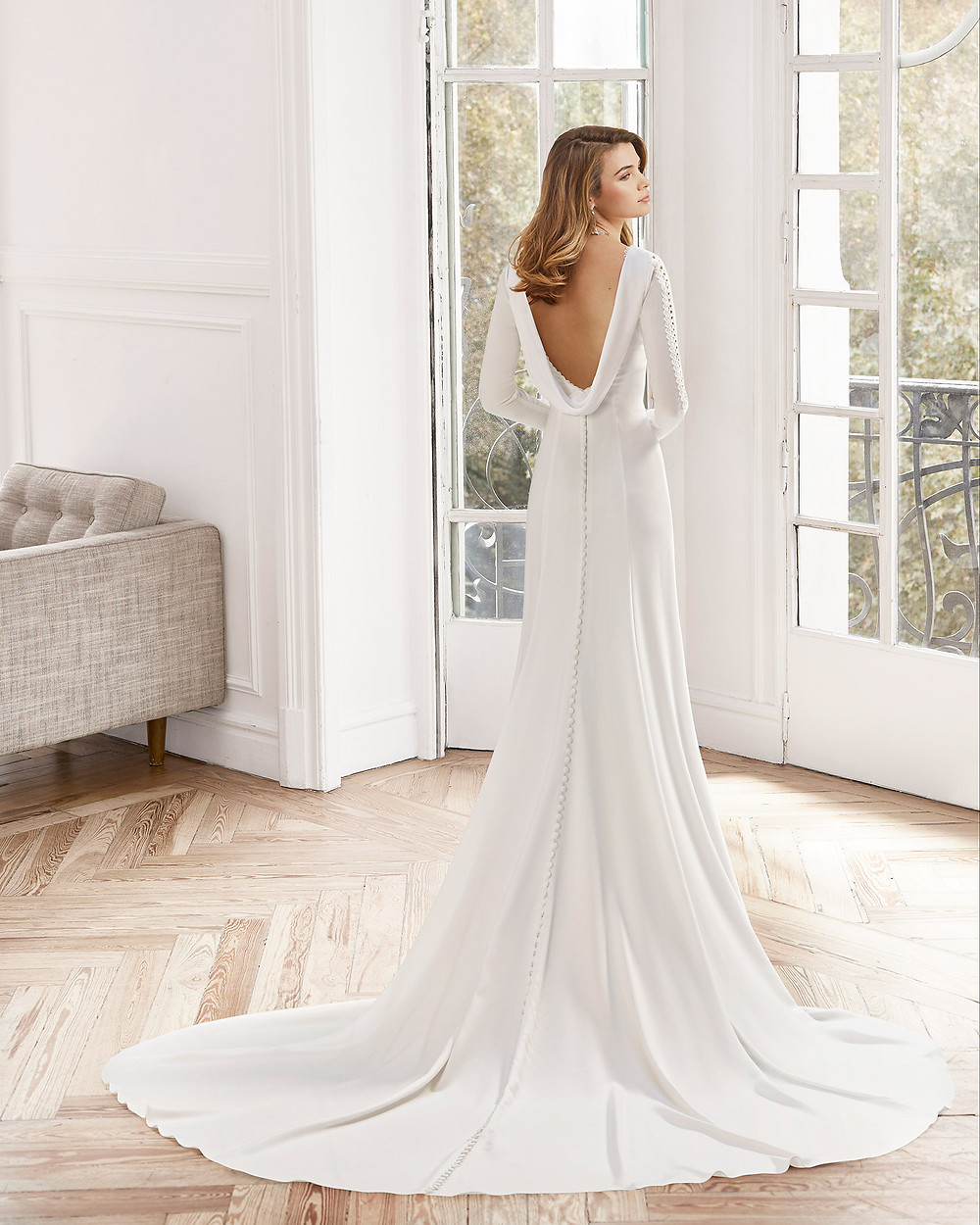 An Aire Barcelona 2020 simple crepe A-line wedding dress with a cowl back