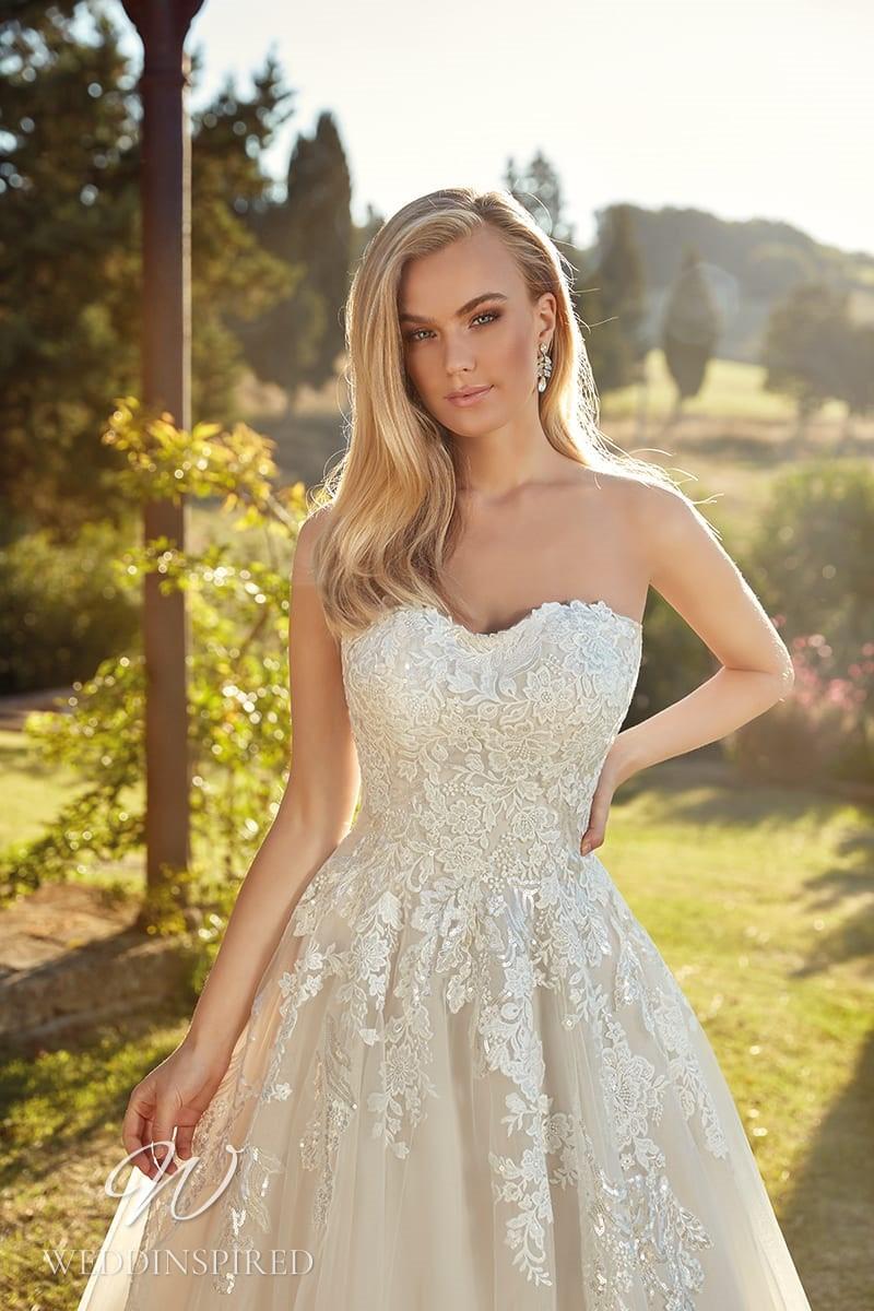 An Eddy K 2021 strapless ivory lace A-line wedding dress