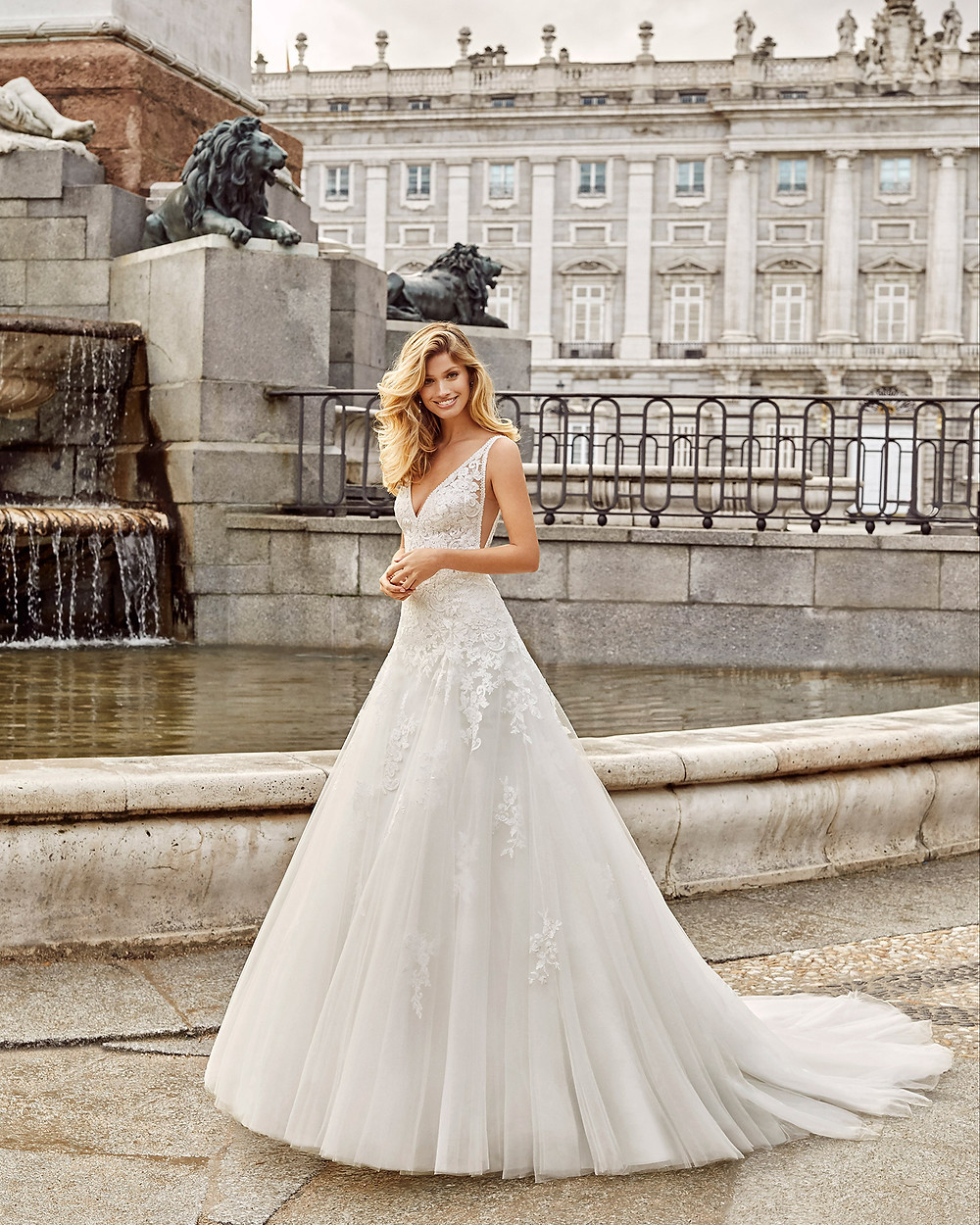 An Aire Barcelona 2020 lace and tulle ball gown wedding dress with a v neckline and straps